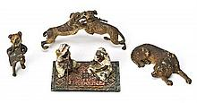A Viennese paperweight and three bronze sculptures, late 19th Century