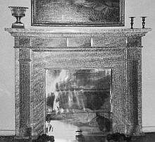 A greenish marble fireplace, circa 1820-1840