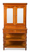 A turning and carved satin Napoleon III writing desk-bookcase, from the third quarter of the 19th Century