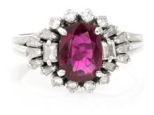 Ring with a ruby within a border of diamonds