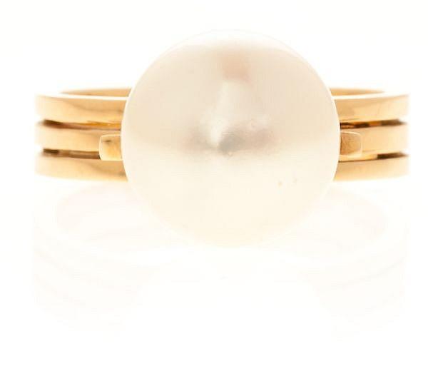 Sortija en oro y perla central