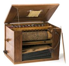 Portable bellows and cylinder organ with case in wood with fillets, from the second half of the 19th Century
