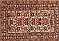 Four oriental woollen rugs, 19th Century