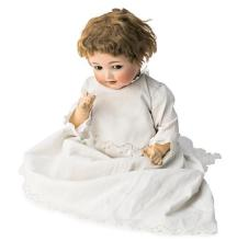 German Kammer & Reinhart baby doll with porcelain head and composition body, circa 1920