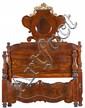 Cama isabelina en caoba, palma de caoba, palisandro, raíz y madera tallada y dorada con fileteados en boj, de mediados del siglo XIX