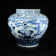 A BLUE AND WHITE FIGURAL JAR
