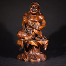 19TH C. A CARVED HUANGYANG WOOD FIGURE