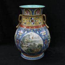 QIANLONG MARK, A BLUE GROUND FAMILLE ROSE VASE