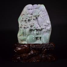 A CARVED JADEITE ORNAMENT WITH STAND