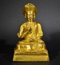A GILT BRONZE BUDDHA FIGURE