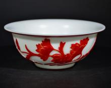 A CARVED OVERLAID GLASS BOWL