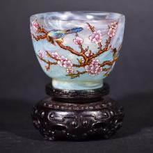 A SMALL ENAMEL GLASS CUP WITH STAND