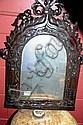 Wall mirror, arch form with a carved wooden frame