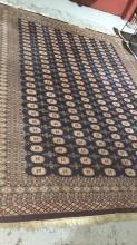 Large vintage Pakistani handmade woollen rug, Princess Bokhara design with camel foot medaillion design on a blue ground, 375 x 286cm