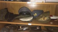 Shelf lot: approx. 13 vintage military caps, berets etc incl. Russian, German, Singapore, Scottish etc