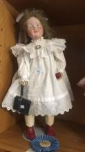 Porcelain doll, reproduction of a Kammer & Reinhardt Dealmaker no. K-R114, porcelain head with fully jointed composition body, 55cm T, handmade mohair wig, fully dressed, note: this doll won 1st prize in the category 'German children dolls' with painted