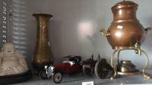 5 items: copper samovar, model cannon, model car, brass vase and a porcelain Buddha