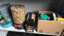 Qty of vintage tins incl. pump, globe etc