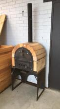 Outdoor cast iron and brick pizza oven with chimney