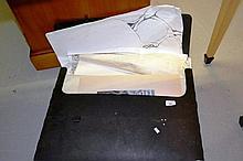 Black plastic art portfolio case containing large