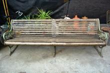 Antique garden bench, large example 246cm L, cast iron ends and middle support section and slatted timber frame, note: some timber slats AF, maker's name cast into side ends 'Cruikshank & Co. Ltd'