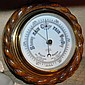 An oak framed wall barometer with carved rope
