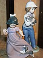 2 Nao figurines by Lladro, 1 of a young boy & 1 of