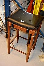 Vintage Parker teak single bar stool, black vinyl