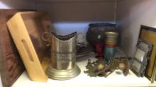 Silverplate wine bottle holder, wall sconces, a crucifix, aluminium cups, photo frames, wooden tray etc
