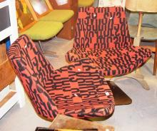 2 designer swivel chairs, orange & black font motif upholstery, un branded
