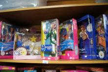 Shelf lot: 7 boxed Barbie dolls, all Sydney 2000 Olympic related, incl. 'Olympic Fan', 'Olympic Pin Collector', 'Paralympic Champion', 'Swimming Champion' etc. Note: All dolls still in box and unused