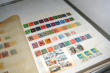 Stamp album containing collection of assorted world stamps