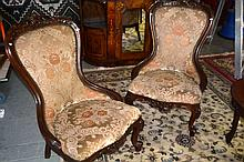 Pair of carved walnut ornate side chairs,