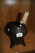 Unusual early cast iron mortar and pestle used for
