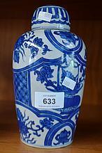Decorative blue & white lidded jar, floral detail,