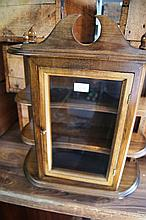 Glass fronted, wall mounted trinket cabinet