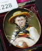 An antique, hand painted porcelain plaque with a