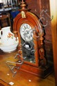 An antique Ansonia shelf clock, with an ornate,