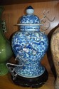 A large, antique, lidded Chinese pot, blue and