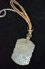 Pale celadon jade pendant, carved with scholars