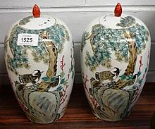 Pair of ovoid shape covered jars, decorated with