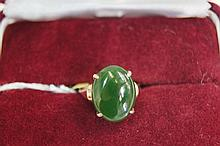18ct yellow gold ring set with single oval jade