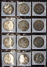 Collection of 12 white metal coins, each different