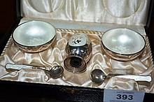 Boxed Danish sterling silver & hand enamelled S&P; set, comprising 2 salt bowls, each with a matching spoon and a pepper shaker all with sterling silver harllmarks, white enamelled detail, very slight AF to one spoon, combined weight approx. 86 grams