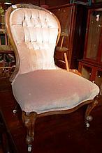 Antique bedroom slipper chair, carved frame, pink velour button back upholstery, on original  white castors