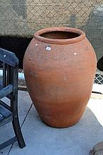 Large terracotta urn style planter, stands 95cm H 60cm D