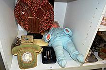 Shelf:circular table lamp, modern bamboo designs vintage doll, a retro phone with material  covering, an old electric razor etc