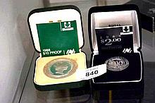 2 silver coins: a 1988 $10 proof and a 1988 $2 proof, both in case with certificate