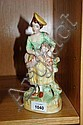 Antique Staffordshire figure of a woman holding a