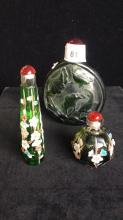 Three green glass snuff bottles, one carved with Koi fish in lotus pond, 12 cm H, the other two facetted and decorated with prunus branches, 11cm H and 6.5 cm H, ( 3 items)